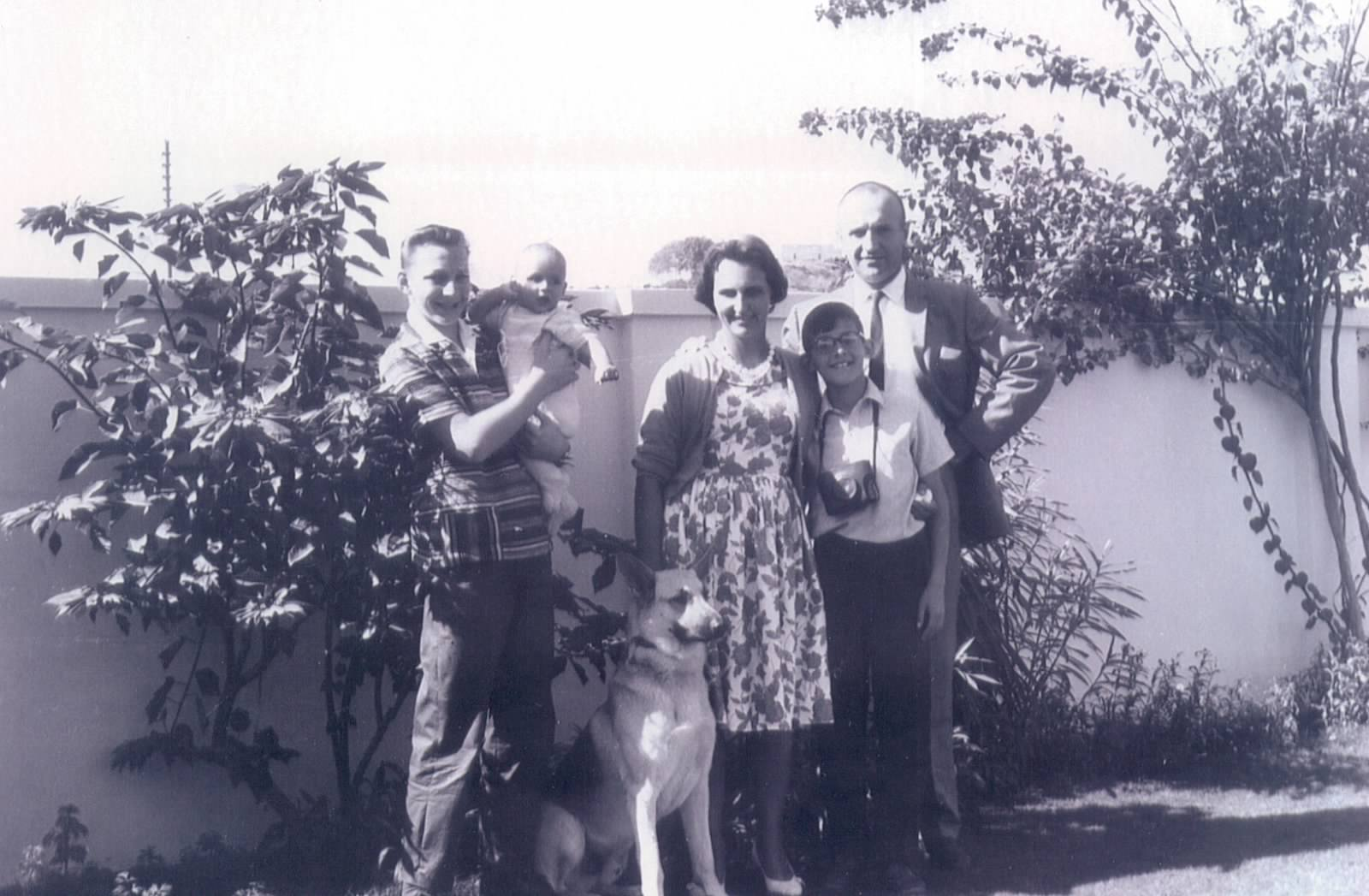 Jan with his parents, brother and dog in their family home in Karachi